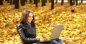 autumn girl on computer